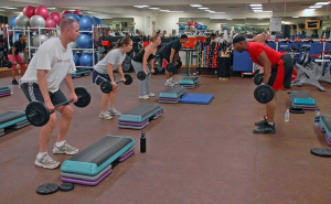 People lifting weights in a fitness center.