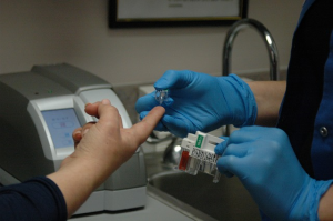 Nurse taking blood for blood sugar test